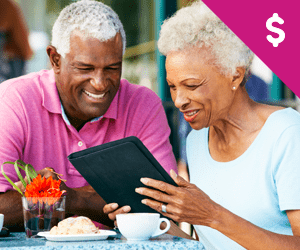 An elderly couple looking at their financial portfolio over desert