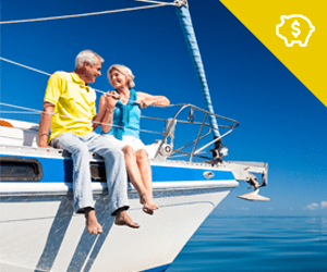 An elderly couple sitting on a sailboat