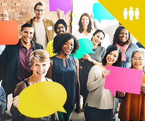 A group of professionals smiling and holding speech balloons